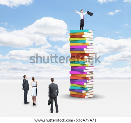 Group of businesspeople looking up to successful businessman standing on pile of books. Sky background. Education and success concept