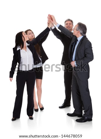 Group Of Businesspeople Raising Hand Together Over White Background - stock photo