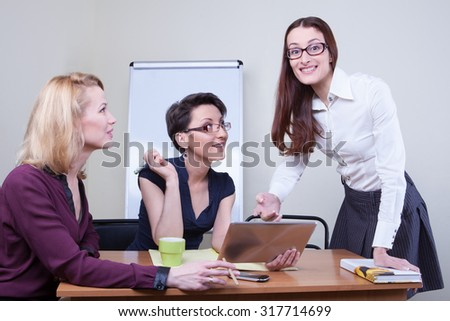 Group of businesspeople sitting and working together - stock photo