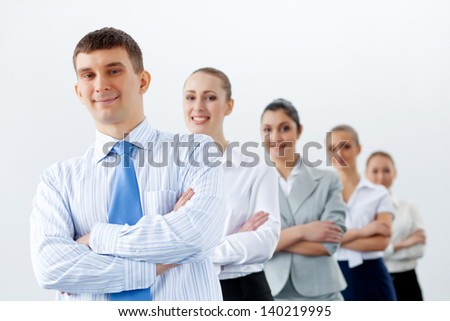 Group of businesspeople smiling standing with arms crossed - stock photo