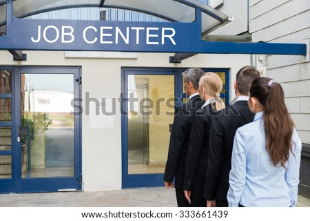 Group Of Businesspeople Standing In Row Outside The Job Center - stock photo