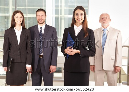 Group of businesspeople standing together - stock photo