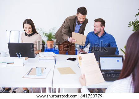 Group of businesspeople working in office.