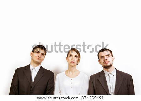 Group of businesswoman and businessmen looks up. Space for text - stock photo