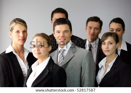 Group of businesswomen and businessmen - stock photo