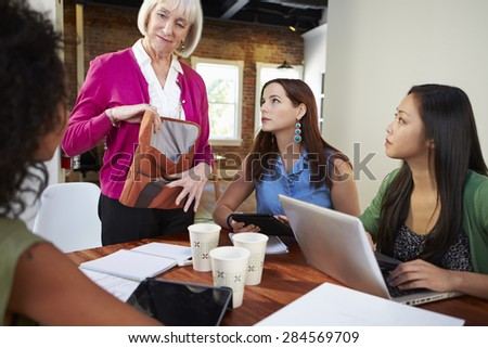 Group Of Businesswomen Meeting To Discuss Ideas