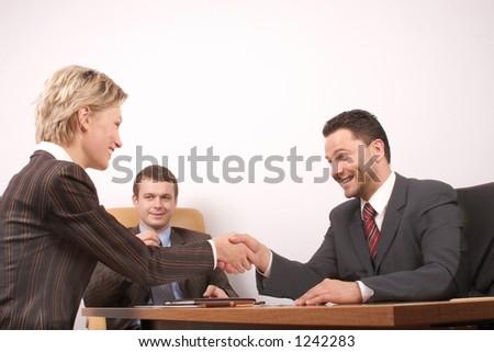 Group of  3 busisness people - man and woman hand shake - stock photo