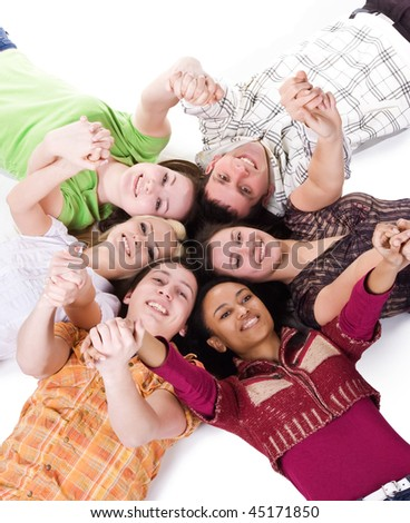 Group of carefree teenagers lie on the floor