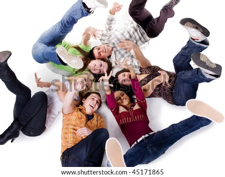 Group of carefree teenagers lie on the floor - stock photo
