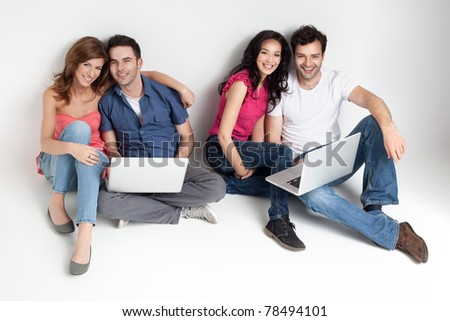 group of carfree beautiful friends with laptops