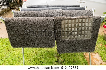 Group of carpet car on Drying rack