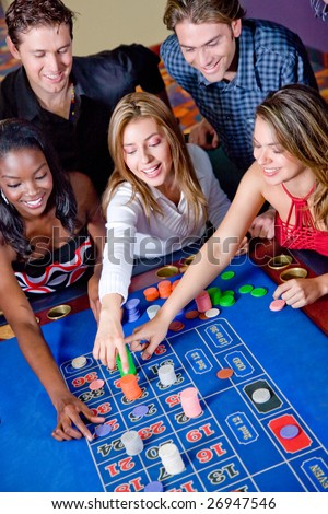 Group of casino gamblers on the roulette - stock photo