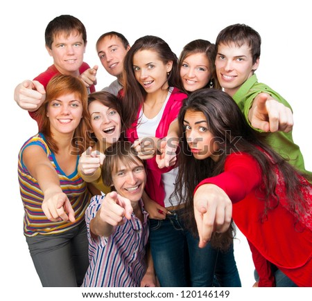 group of casual happy people smiling and shows fingers at the camera - stock photo