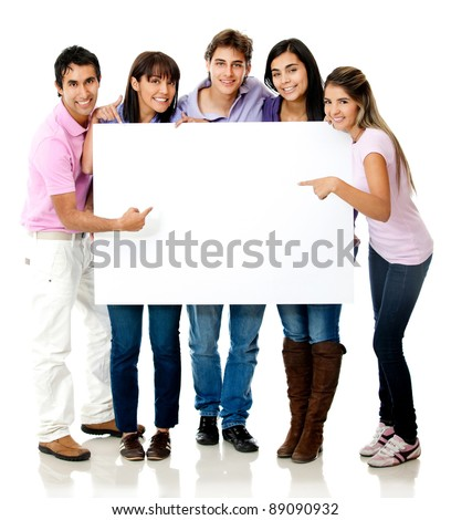 Group of casual people pointing at a banner - isolated over a white background