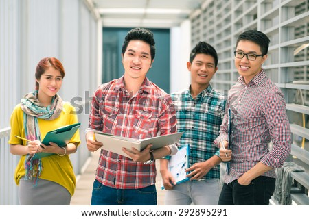Group of casual Vietnamese business people - stock photo