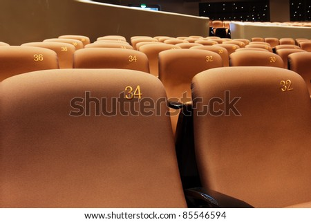 Group of chairs in modern theatre interior - stock photo