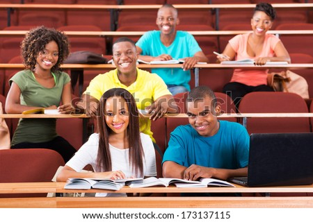 group of cheerful african college students in lecture room - stock photo