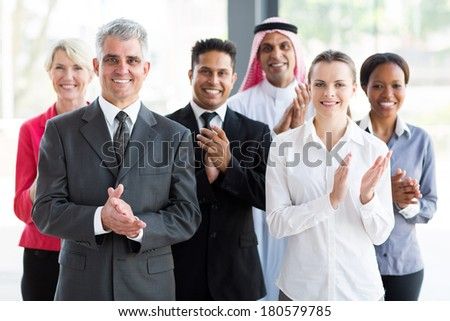 group of cheerful business people applauding - stock photo