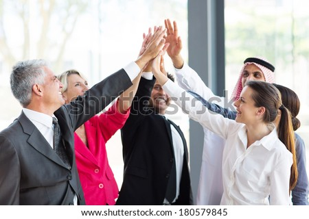 group of cheerful businesspeople team building - stock photo