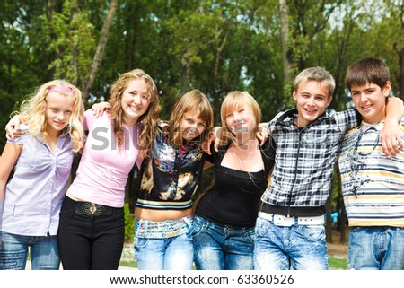 Group of cheerful college friends - stock photo