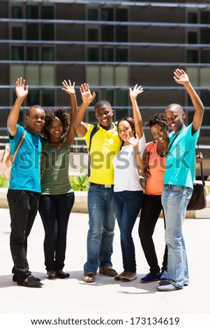 group of cheerful college students waving - stock photo