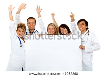 group of cheerful doctors holding a banner ad isolated over white - stock photo