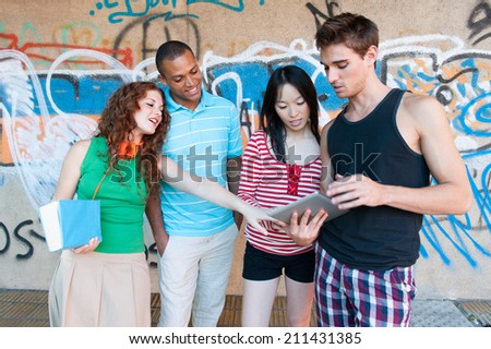 Group of cheerful friends. multi ethnic. Outdoors. - stock photo