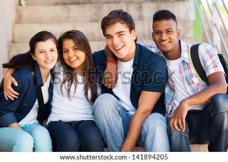group of cheerful high school students friends - stock photo