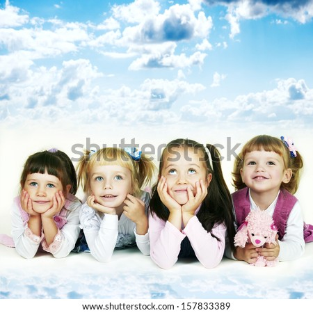 Group of cheerful little girls on a sky background - stock photo