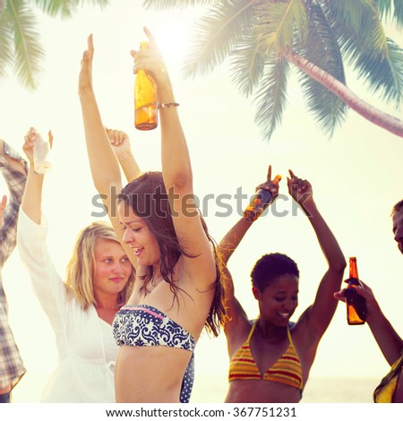 Group of Cheerful People Partying on a Beach Concept - stock photo