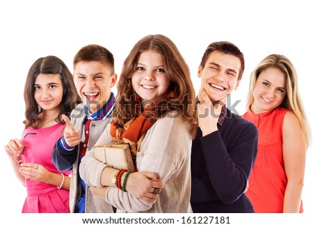 Group of cheerful teenagers on the white background - stock photo