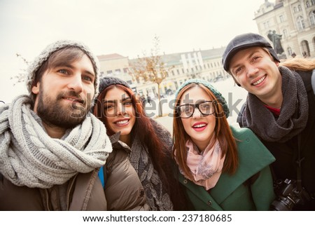 Group Of Cheerful Tourists Taking Selfie Outdoors - stock photo
