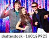 Group of cheerful young people dancing at the nightparty. - stock photo
