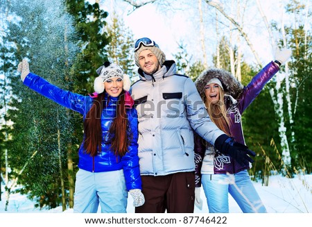 Group of cheerful young people having winter rest outdoor. - stock photo