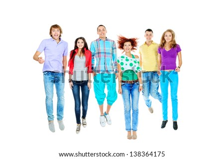 Group of cheerful young people jumping together. Isolated over white background.