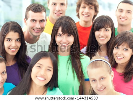 Group of cheerful young people posing together. - stock photo