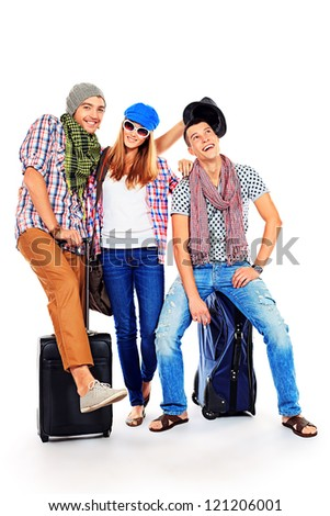 Group of cheerful young people standing together with suitcases over white background. - stock photo