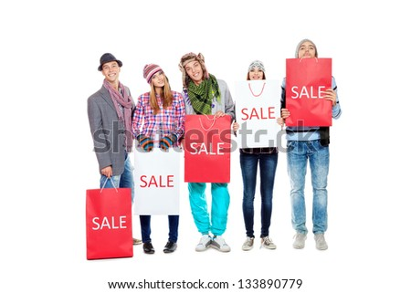 Group of cheerful young people with shopping bags. Isolated over white background. - stock photo
