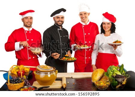 Group of chef team showing food and smiling isolated on white background - stock photo