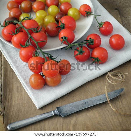 group of cherry tomatoes on a rustic background