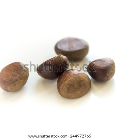 Group of chestnuts on white background - stock photo