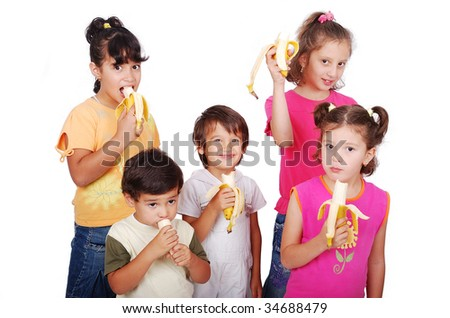 Group of children eating banana isolated - stock photo