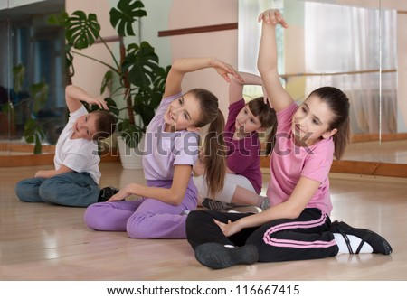 group of children engaged in physical training in the gym. Horizontal. - stock photo