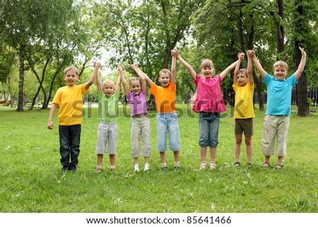 Group of children having fun together in the park - stock photo