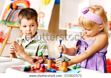 Group of children  in preschool - stock photo