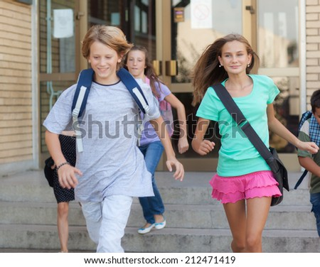 Group of children late for school. - stock photo