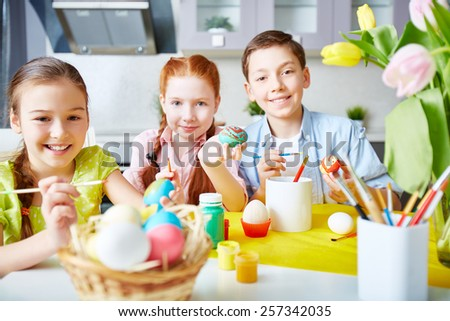 Group of children painting Easter eggs - stock photo