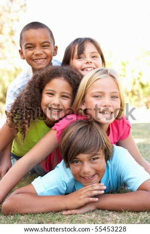 Group Of Children Piled Up In Park