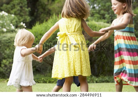 Group Of Children Playing Outdoors Together - stock photo