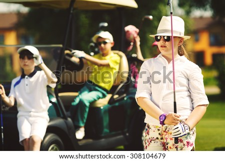 Group of children practicing in golf school - stock photo